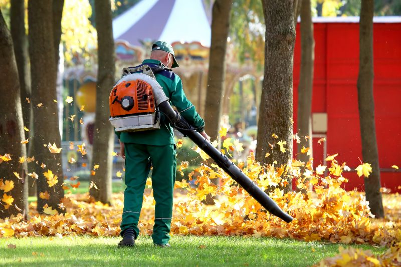 man leaf blowing
